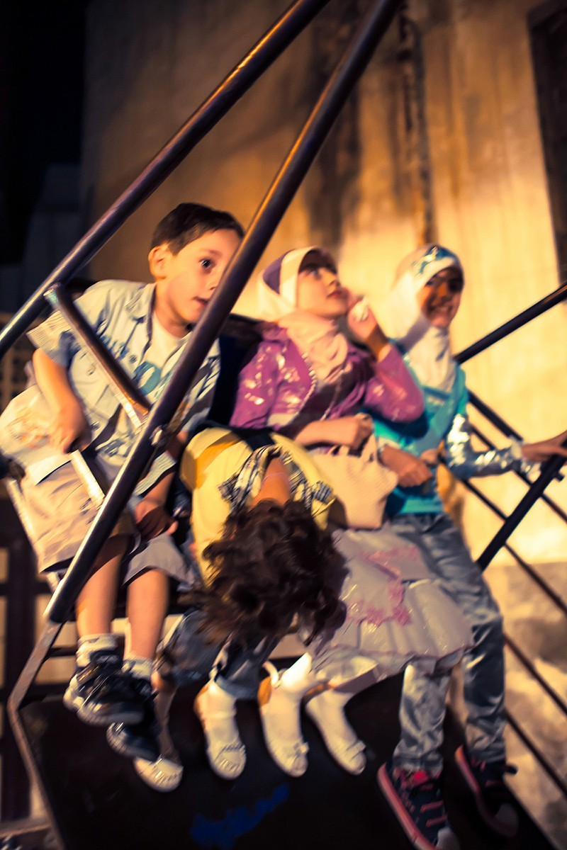 "Children enjoying a swing in Central Damascus. FOR GALLERY FOR PHOTOGRAPHY PAGE.- TO GO LIVE EARLY SEPTEMBER,.... FOR GALLERY/SLIDESHOW FOR PHOTOGRAPHY PAGE ? CAN BE PRODUCED ANY TIME BUT SHOULD GO LIVE IN EARLY SEPTEMBER...  AN IMPERFECT NORMALITY An Imperfect Normality is a retrospective exhibition of pictures by Tommie Lehane of a Syria that was. Like dozens, and more, periods throughout Syria?s long history, this time is now past and consigned to the history books. Currently ravaged by war and chaos, it is hard to imagine a place that, to those who lived within its territory or who crossed its borders, was a relatively normal place to be. This work seeks to document a normality whilst hinting at its imperfections and considering the effect of war as a method of change.  The Images are from 2005 and 2009 when the photographer visited initially as a tourist and on the second occasion stayed mainly in the house of a friend in a tiny village. He was there for a few weeks for each period of shooting.  Al Hamidiyah village The work is focused around the normality of life in a place where the obvious undercurrents have now resulted in the awful situation that now exists. Lehane had planned to return in 2012 to focus on the ""Greeks of Al Hamidiyah"", the village where some of these images were taken, but events overtook his plans and through war the Syria he had come to know no longer exists.    Lehane's practise is primarily centered on the exploration of place. Unusually, he has a dual focus on the Middle East and a small village Castlegregory, in the Dingle Penninsula. Tommie has been widely exhibited in Ireland and Europe and also at the start of 2015 in war torn Aleppo in Syria.   In 2014 Tommie Lehane was the recipient of the Alliance Fran?aise Photography Laureate. The exhibition runs in the Fire House Gallery Dublin from September 10th to September 25th."